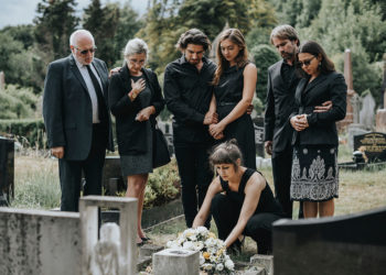 Grieving family at cemetary